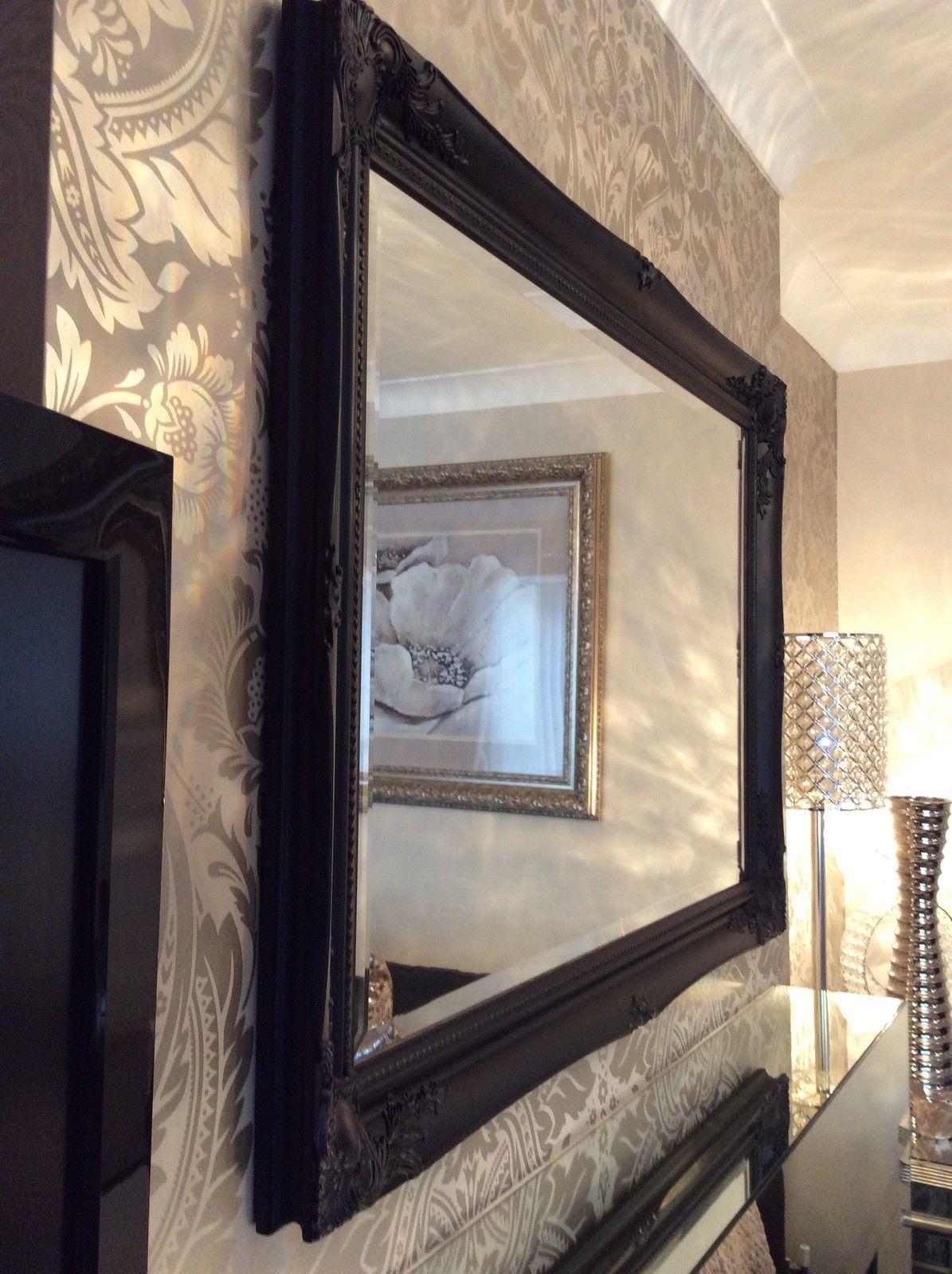 Large black framed wall mirror